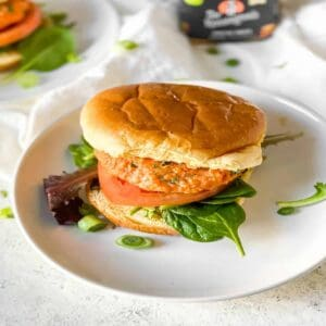 salmon burger on a white plate