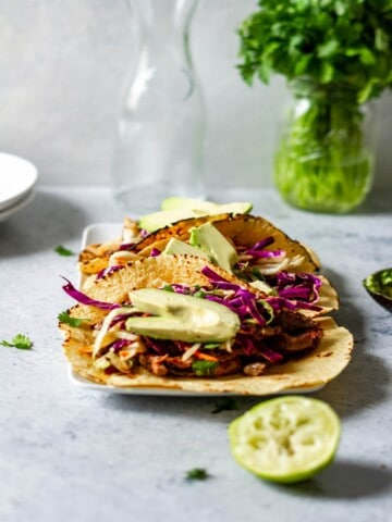 a taco filled with korean beef, slaw and avocado slices