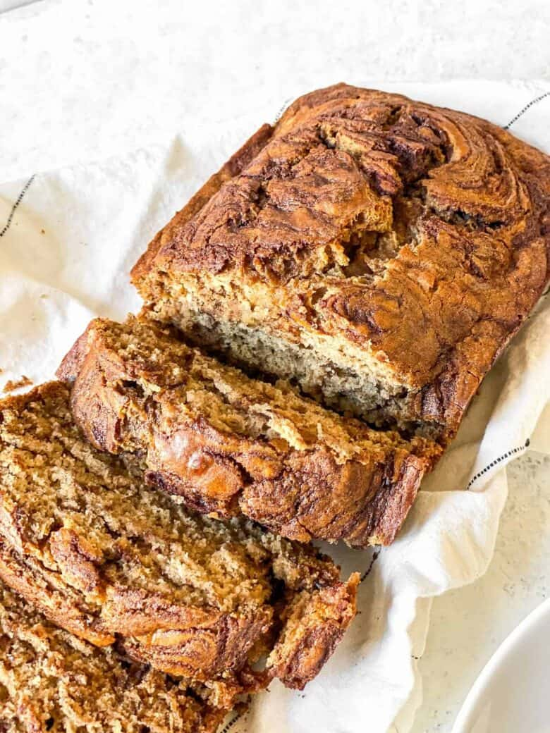 banana bread loaf with 3 slices cut