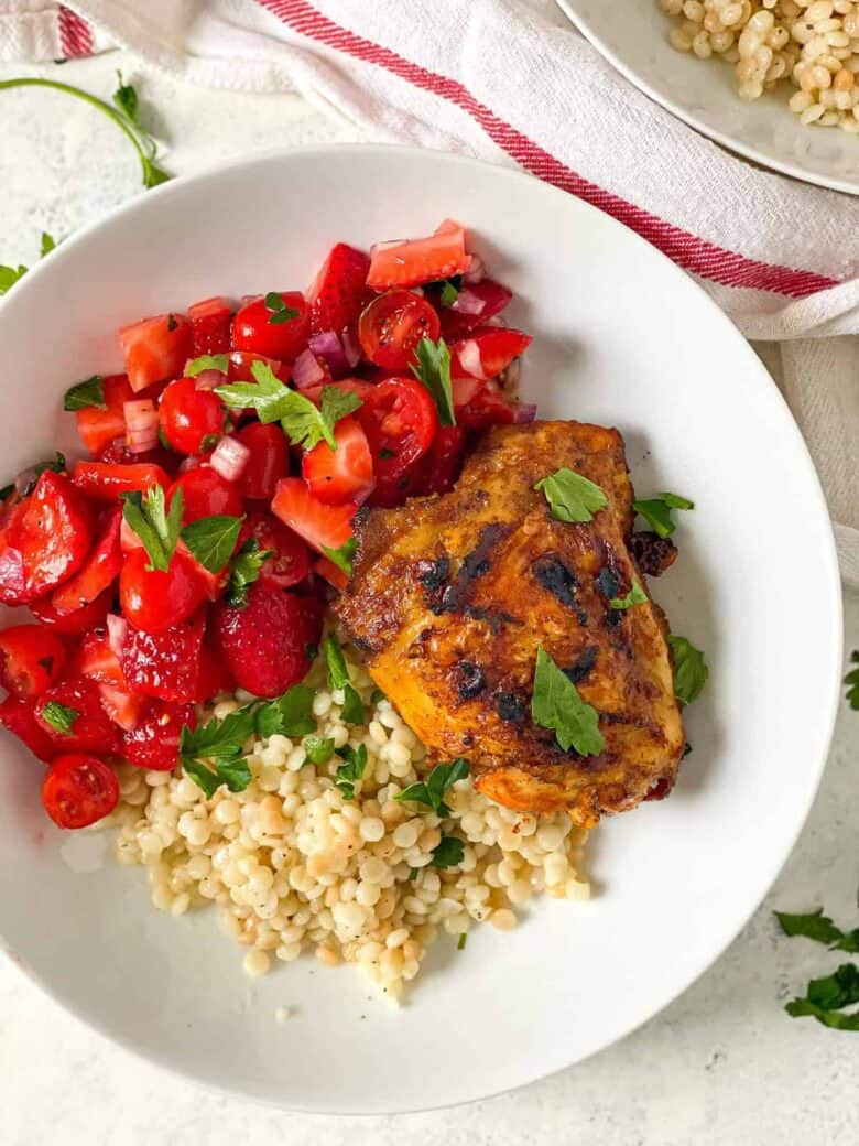 grilled chicken with strawberry tomato salad and couscous