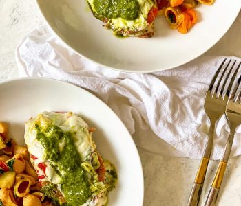 pesto mozzarella chicken with vegetable pasta on 2 plates