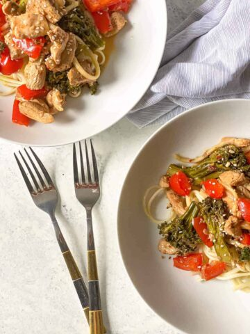 chicken and veggie stir fry over noodles