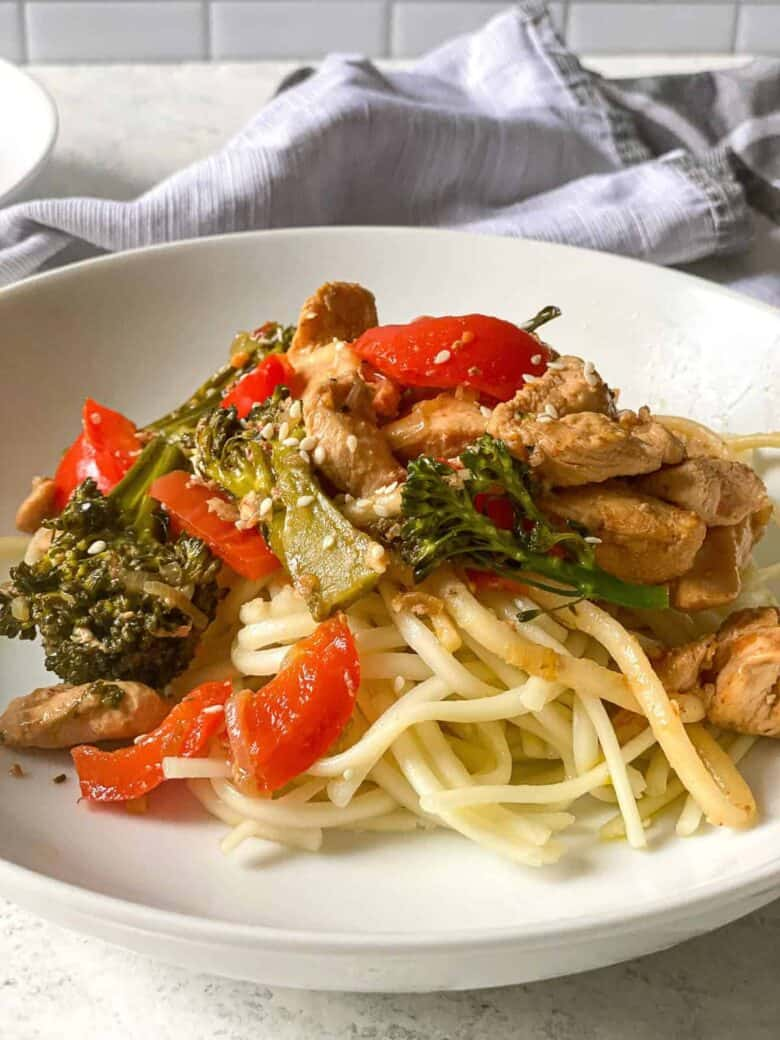 chicken and veggies on top of soba noodles