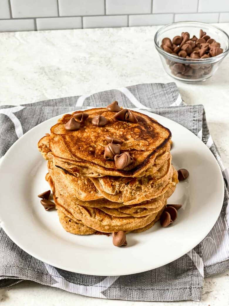 stack of banana pancakes topped with chocolate chips