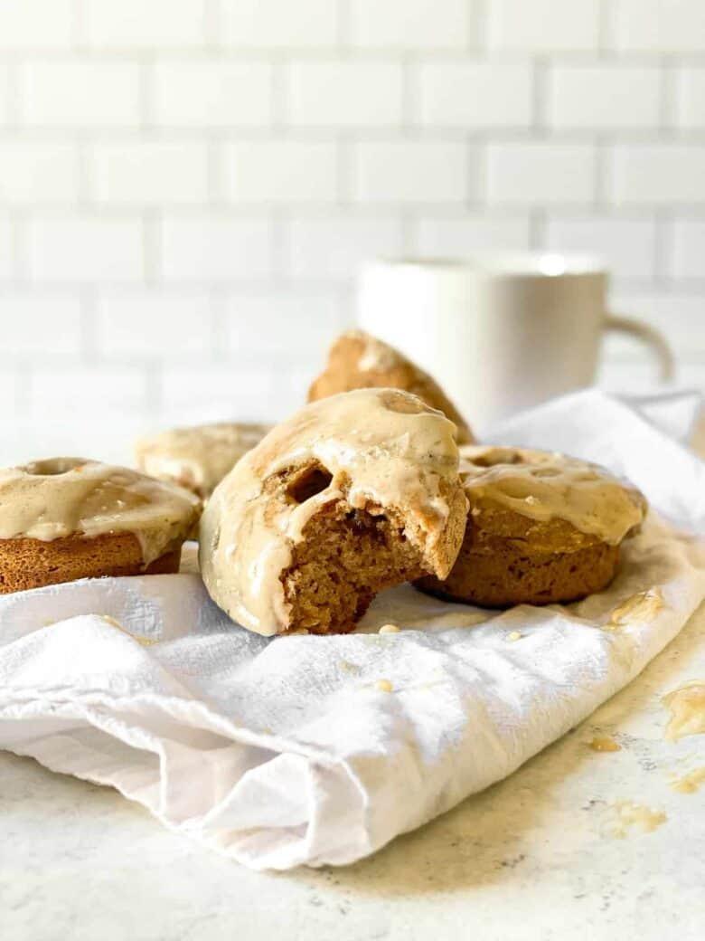 maple glazed donuts and a white mug
