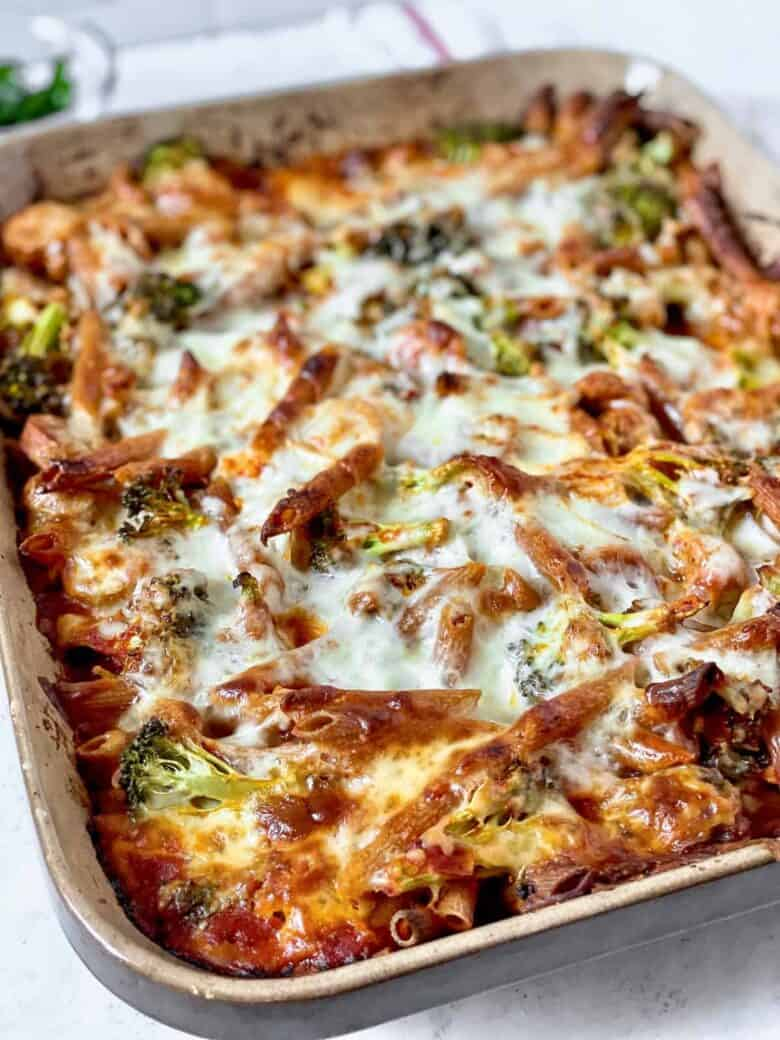 easy pasta bake with broccoli, mozzarella cheese and sauce in a large baking dish