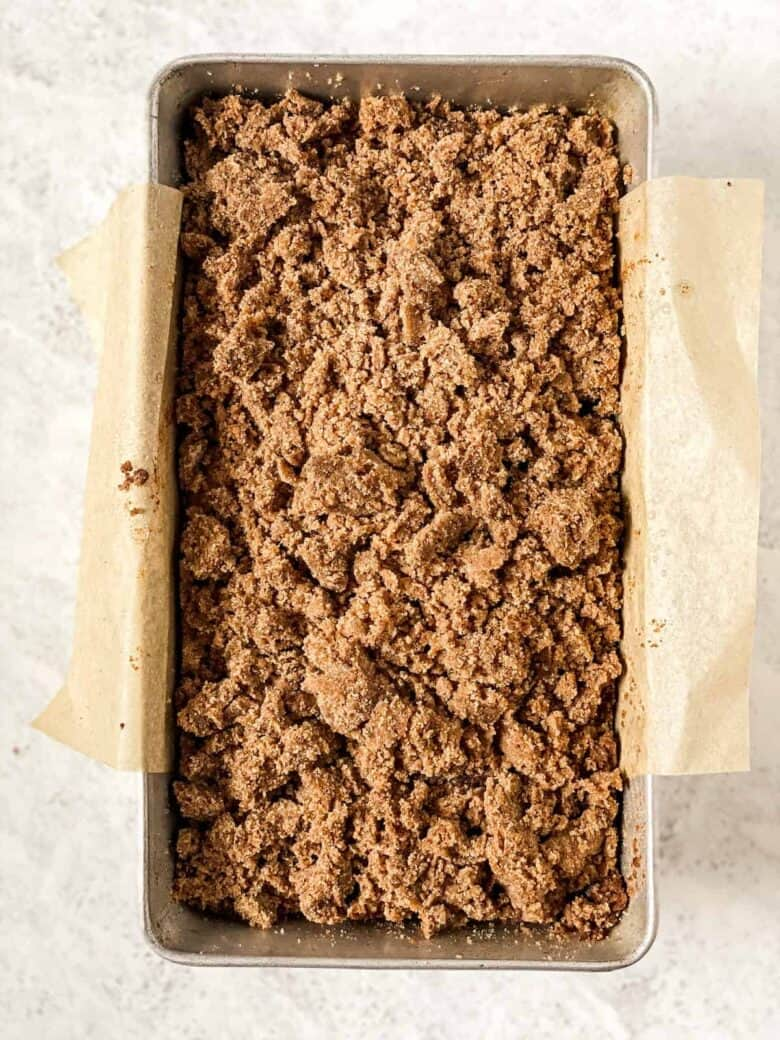 apple cinnamon bread with crumb topping in a loaf pan