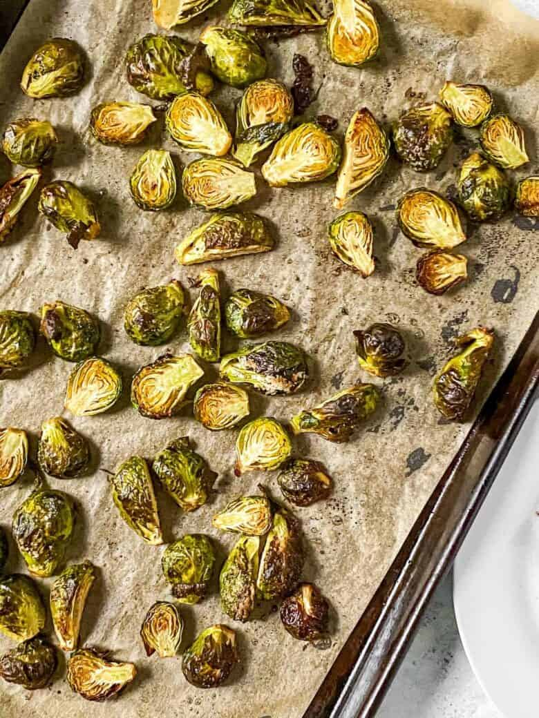 cut brussels sprouts baked on a sheet pan