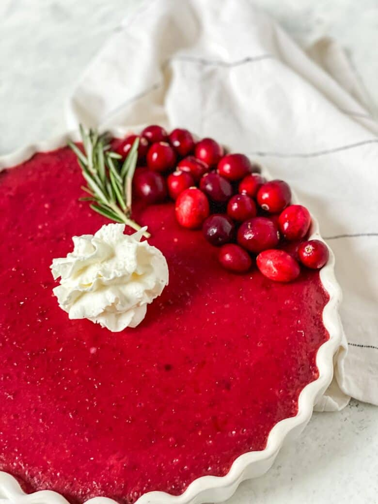 cranberry lemon tart topped with whipped cream