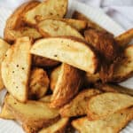 potato wedges on a white plate
