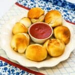 pizza rolls with a bowl of marinara sauce