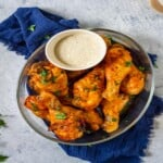 chicken drumsticks served with dipping sauce